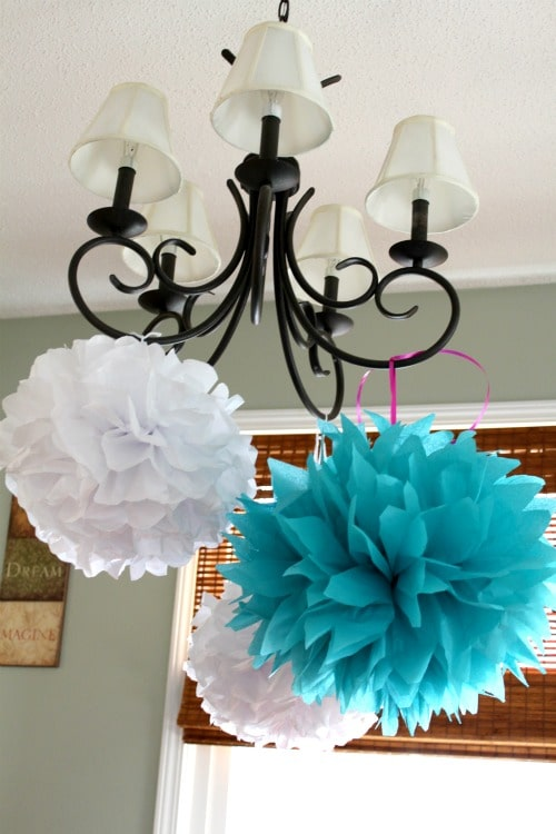 How to make tissue paper pom poms easily all things mamma for Hanging pom poms from ceiling