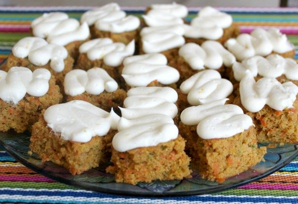 Looking for a way to use up all those zucchini that are popping up - try these quick and easy Zucchini Carrot Bars with Lemon Cream Cheese Frosting today!