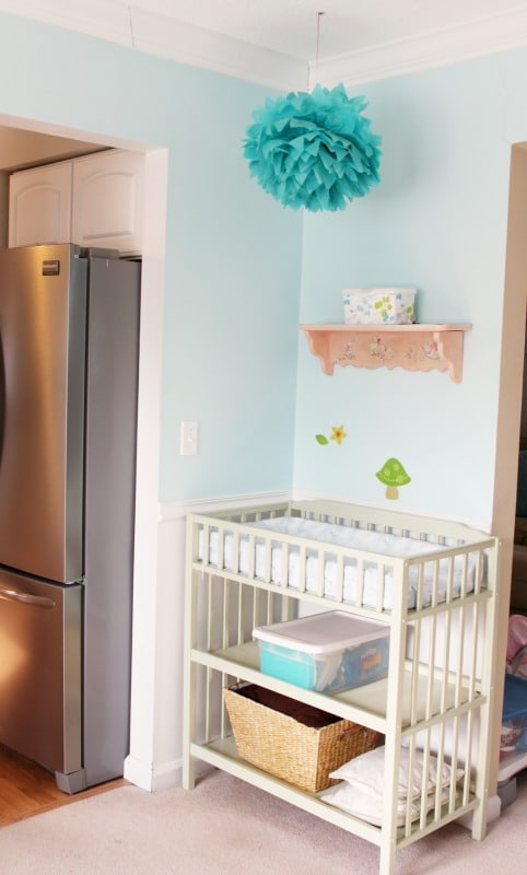 Having a changing area in the playroom is a handy idea!
