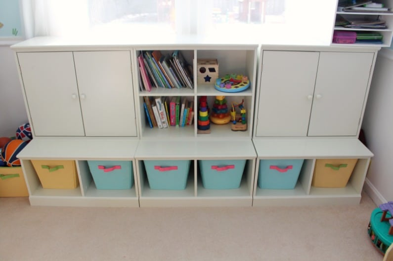 An organizational toy storage unit is so helpful for putting toys away!