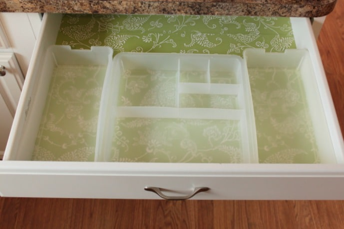 """Using drawer organizers helps to keep """"junk"""" contained and organized."""