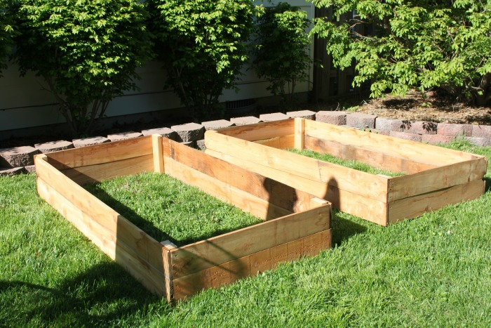 Diy raised vegetable beds for under 30 - What to put under raised garden beds ...