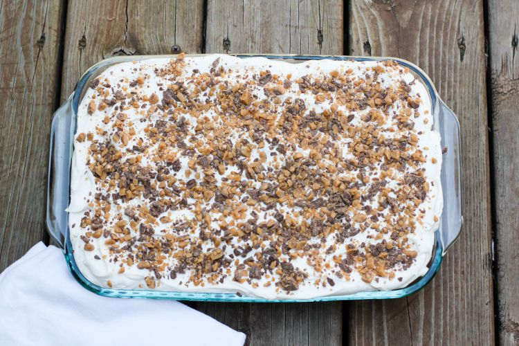 A doctored up cake mix and other store bought ingredients makes this Heath Bar Cake super easy to make and a complete hit every time!
