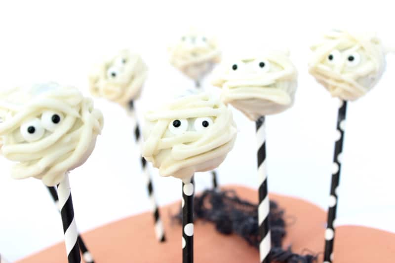 These mummy cake balls are perfect for Halloween. They are a fun and tasty treat! Not only that, the kids get super excited when you mention making a fun Halloween themed treat!