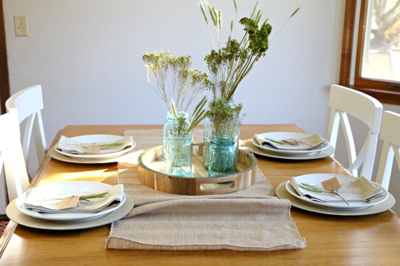 Creating a beautiful and affordable Thanksgiving Tablescape is as easy as looking around your home and yard for items you love. Add in a few store bought elements and you have an easy and affordable table that will dress up your home.