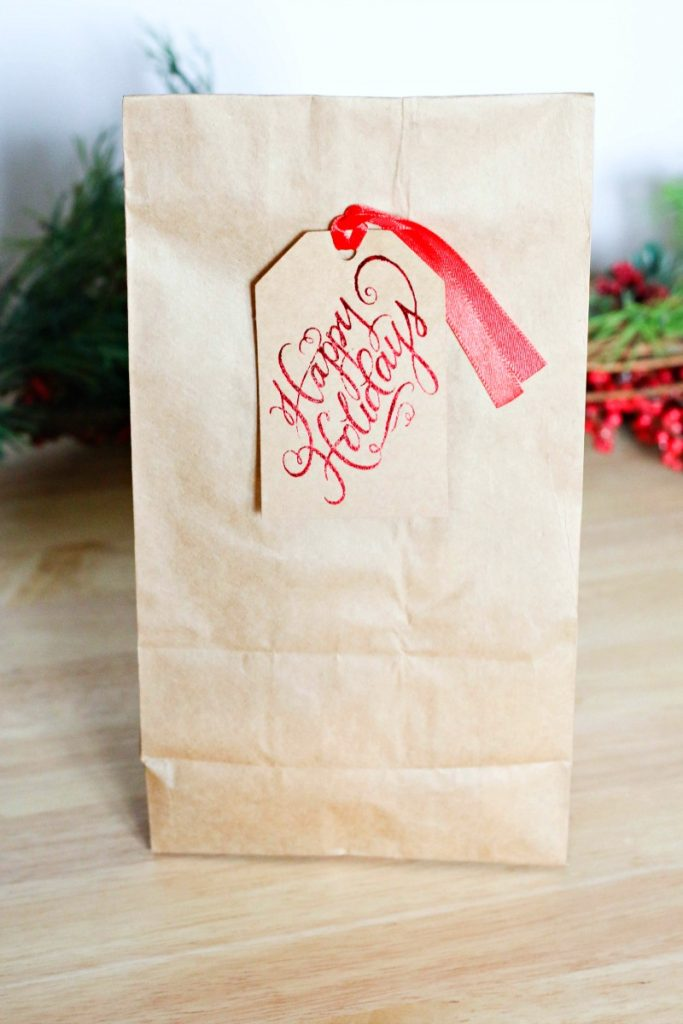 Fill brown bags with lunch items and hand them out to homeless people one Saturday with a little note from your family.