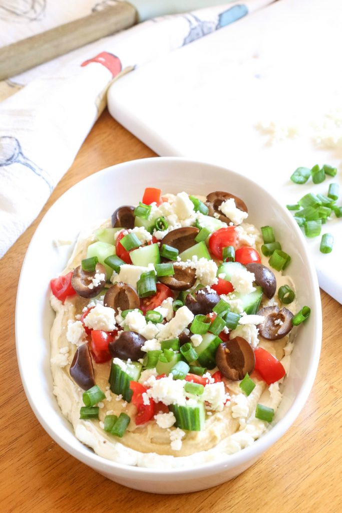 7-Layer Greek Dip - This healthy 7-Layer Greek Dip is so delicious you'll want to eat it with a spoon!