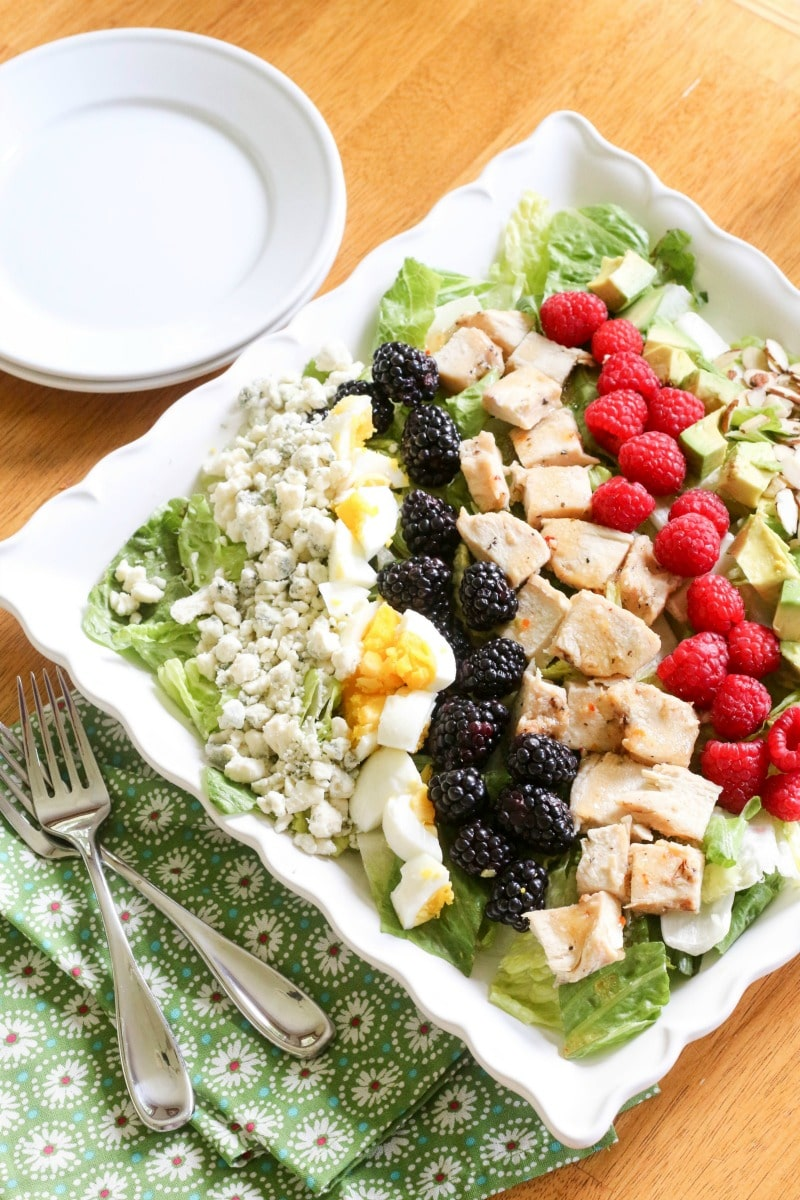 Topped with eggs, blue cheese, raspberries, blackberries, avocado, roasted almonds and chicken, this Summer Cobb Salad packs a wholesome punch!