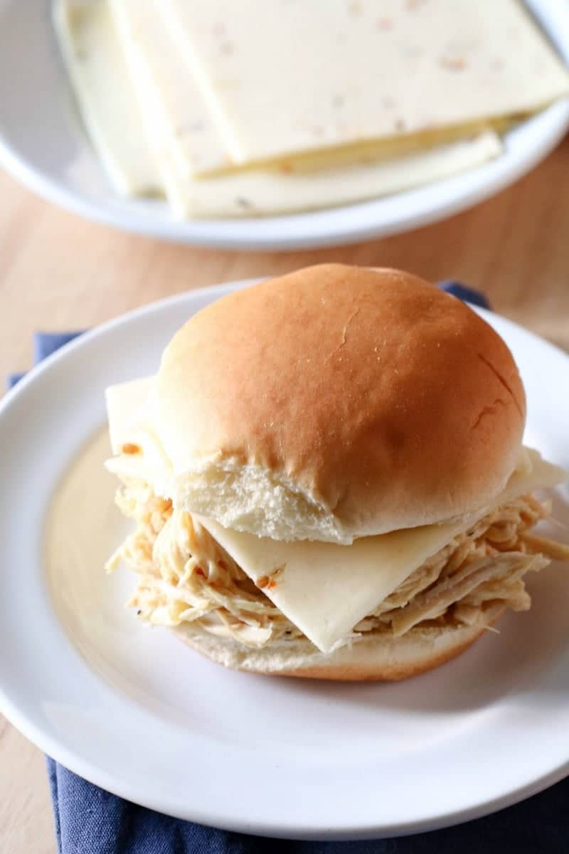 This slow cooker Cheesy Chicken Ranch Sandwich recipe is amazing and so easy! Ready in 3 hours!