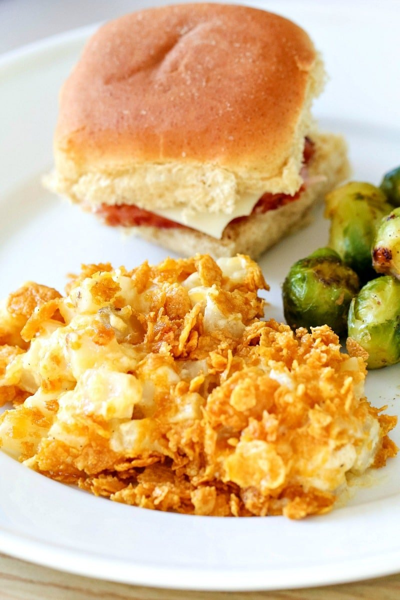 ham and cheese sliders, brussels sprouts, cheesy potatoes on a plate
