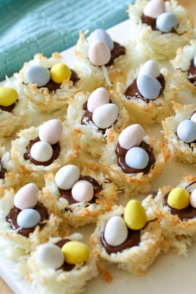 These Coconut Macaroon Nests are filled with dark chocolate and topped with Mini Cadbury Eggs for an adorable and tasty treat!