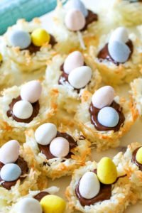 You're gonna love these Coconut Macaroon Nests that are filled with dark chocolate and topped with Mini Cadbury Eggs because they are the perfect Easter treat! #macaroons #coconut #cookies #easter #dessert #allthingsmamma   allthingsmamma.com