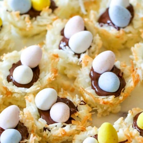 You're gonna love these Coconut Macaroon Nests that are filled with dark chocolate and topped with Mini Cadbury Eggs because they are the perfect Easter treat!  #macaroons #coconut #cookies #easter #dessert #allthingsmamma | allthingsmamma.com