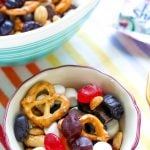 For a delicious snack mix that most every kid will love, mix up this super simple Kid-Pleasing Snack Mix Recipe!