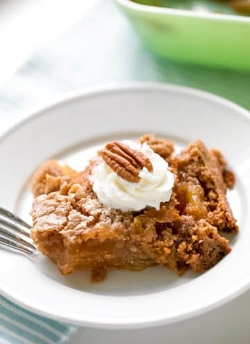 This apple dump cake is the easiest dump cake recipe, with three basic ingredients. If you are looking for an easy fall dessert, this recipe is just that.  Tender bits of apple in every bite covered with a spiced cake that is delicious, down to the last bite. An easy apple dessert you can whip up any time of day. #apple #dessert #dumpcake #falldessert #appledessert #easydesserts| allthingsmamma.com