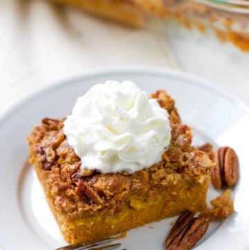 This quick and easy pumpkin dump cake is your next go-to fall dessert. Dump cakes recipes are so versatile and are perfect for serving a crowd or whipping up a quick dessert to feed your family as a treat. An easy pumpkin recipe that is a no-fail recipe. Just mix, dump, and bake. It's that easy.