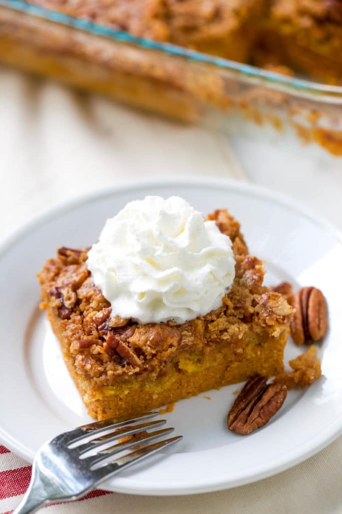 This quick and easy pumpkin dump cake is your next go-to fall dessert. Dump cakes recipes are so versatile and are perfect for serving a crowd or whipping up a quick dessert to feed your family as a treat. An easy pumpkin recipe that is a no-fail recipe. Just mix, dump, and bake. It's that easy. #pumpkin #dumpcake #falldessert #easydessert | allthingsmamma.com