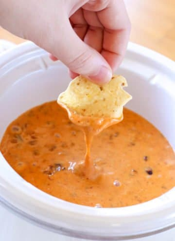With only 2-ingredients, this Chili Cheese Dip is always a hit! Make this quick & easy appetizer in the slow cooker or microwave for a crowd-pleasing dip!