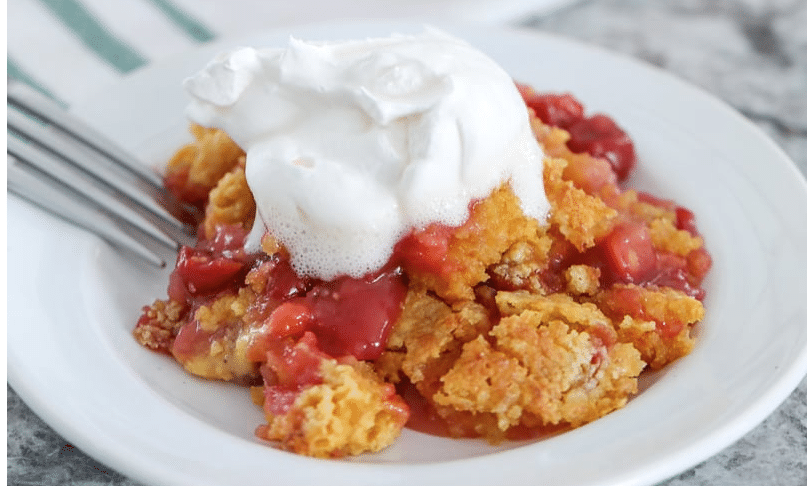 cherry pineapple dump cake with whipped cream