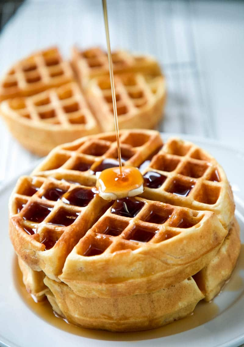 waffle recipe on a plate with syrup pouring over