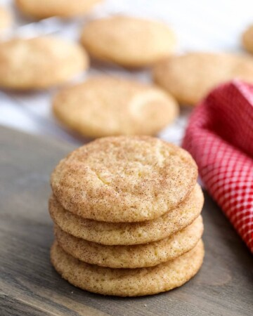 stacked snickerdoodle cookies on a table