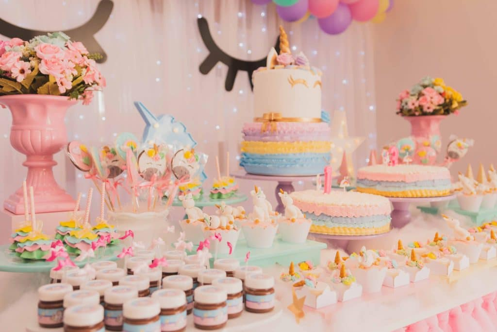 Cake table with variety of cakes.