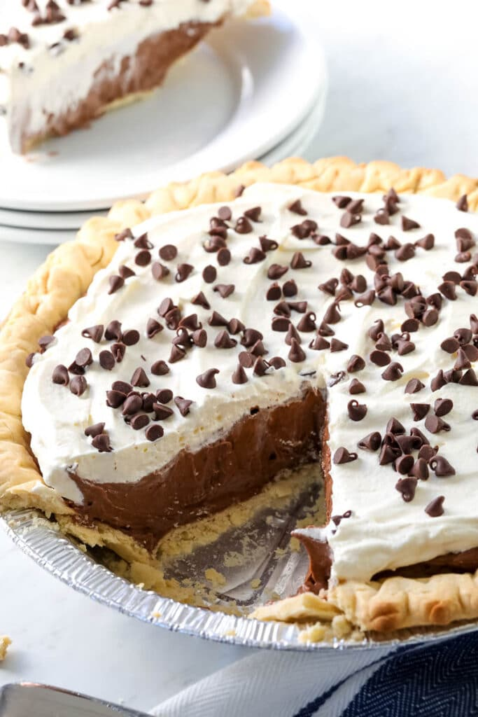 Chocolate Cream Pie in pie plate with a piece missing