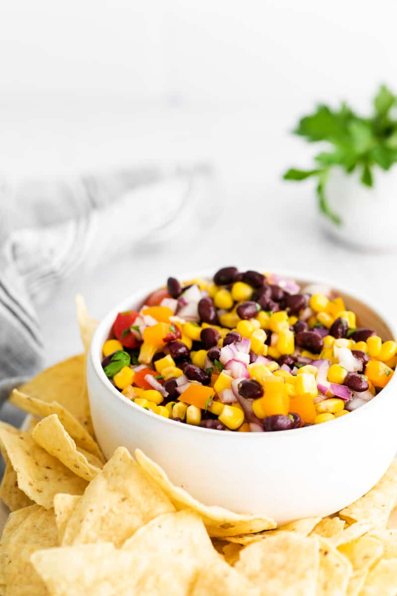 Black Bean and Corn Salsa in white bowl with chips