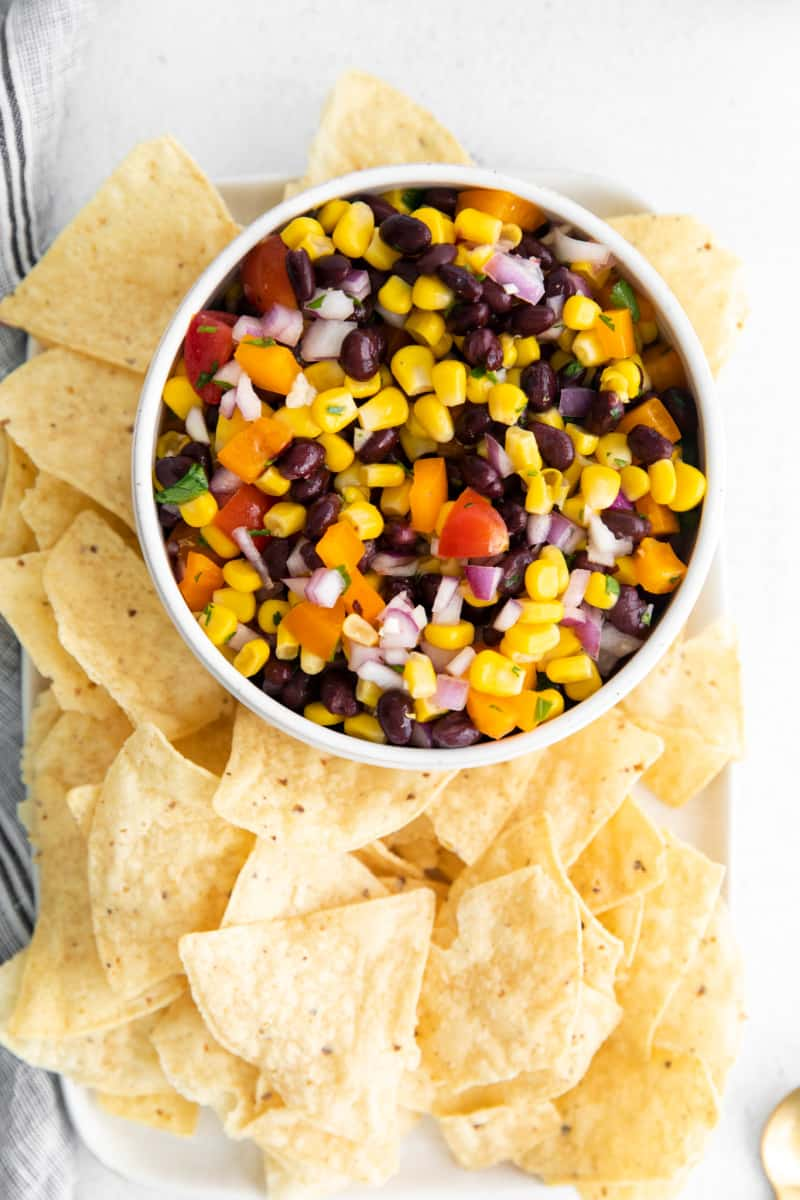 Overhead shot of Black Bean and Corn Salsa in bowl with tortilla chips
