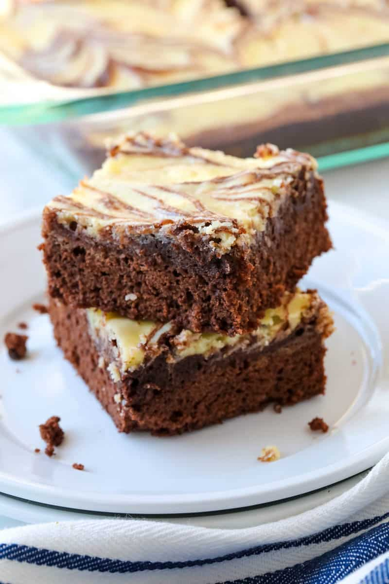 stacked marble brownies on a white plate