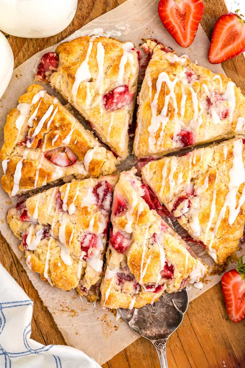 strawberry scones on a cutting board with a serving spoon
