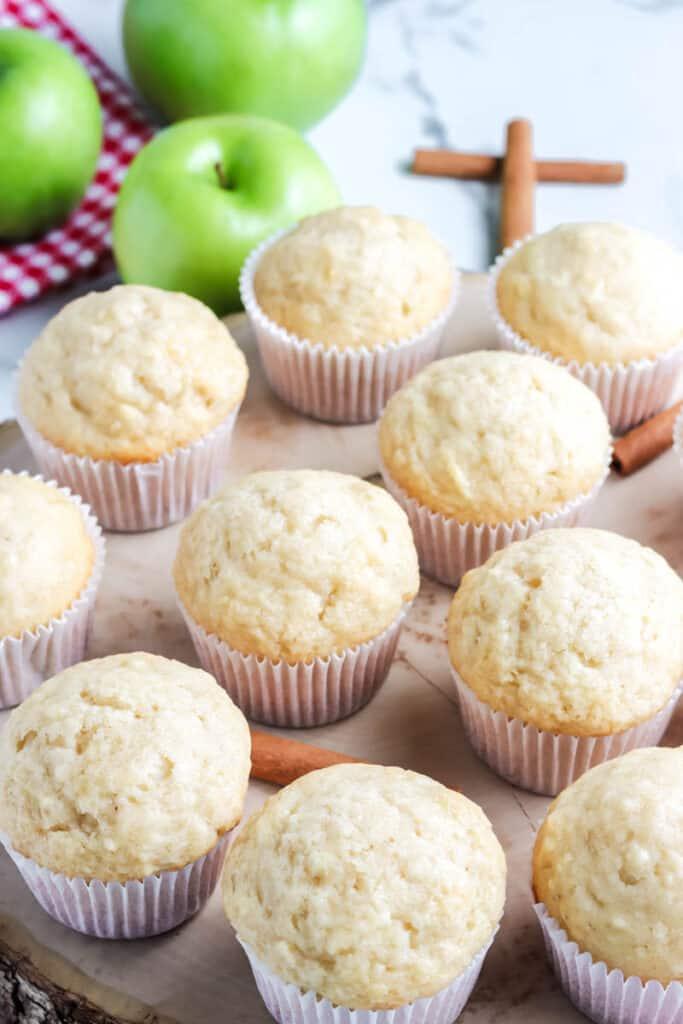 apple cinnamon muffins on a wooden board