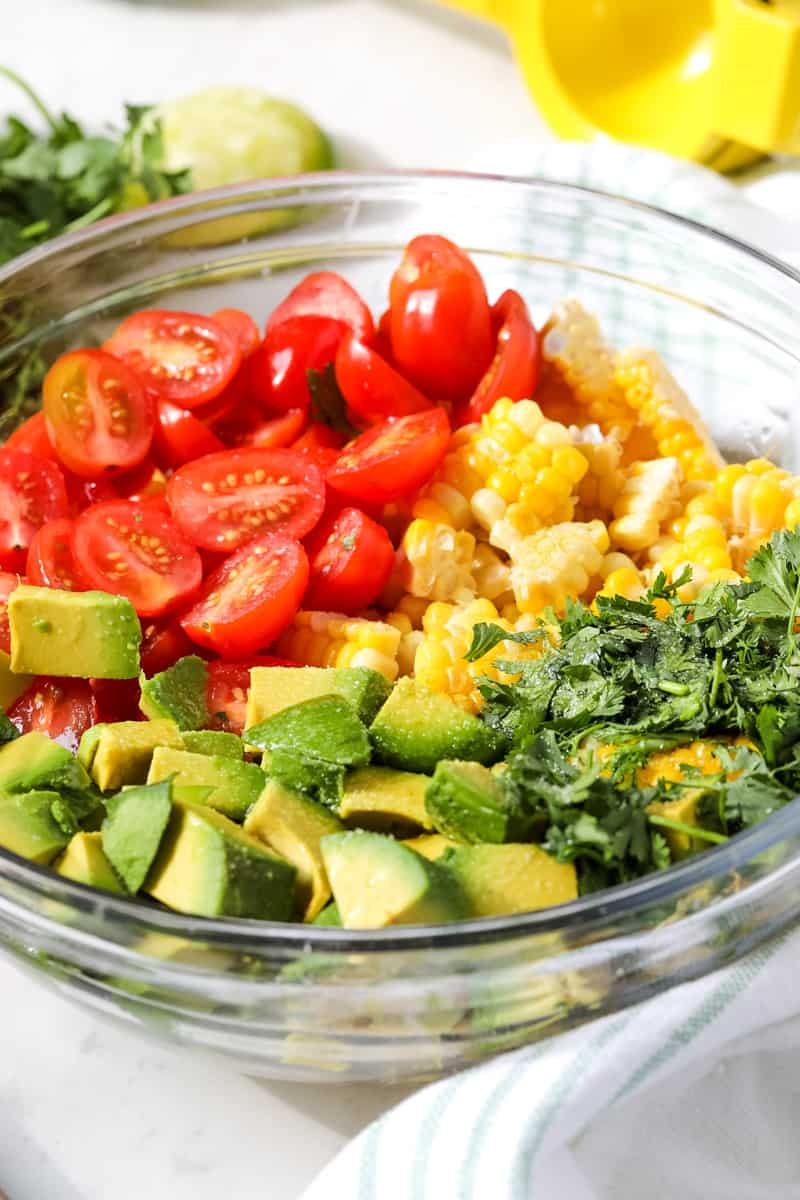 Corn, Avocado & Cilantro Salad ingredients in glass bowl