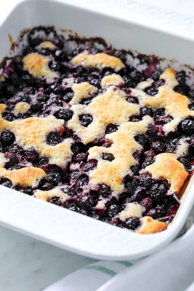 blueberry cobbler in a dish on a table