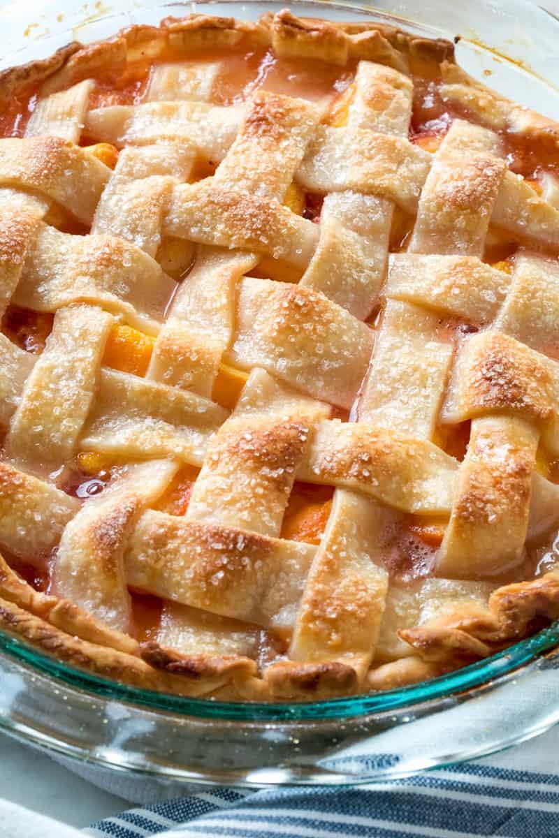 whole peach pie on a table