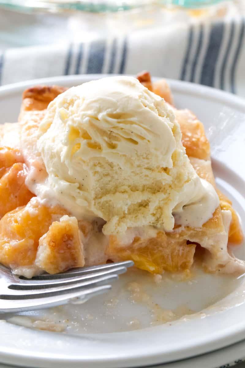 slice of peach pie and ice cream