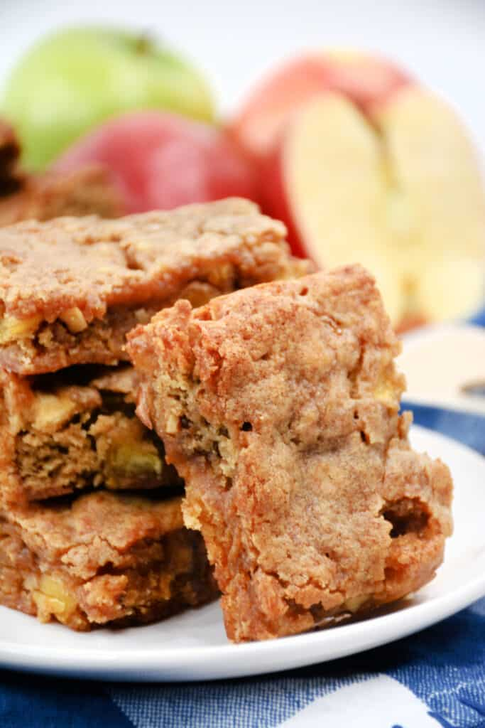 a stack of apple blondies on a white plate