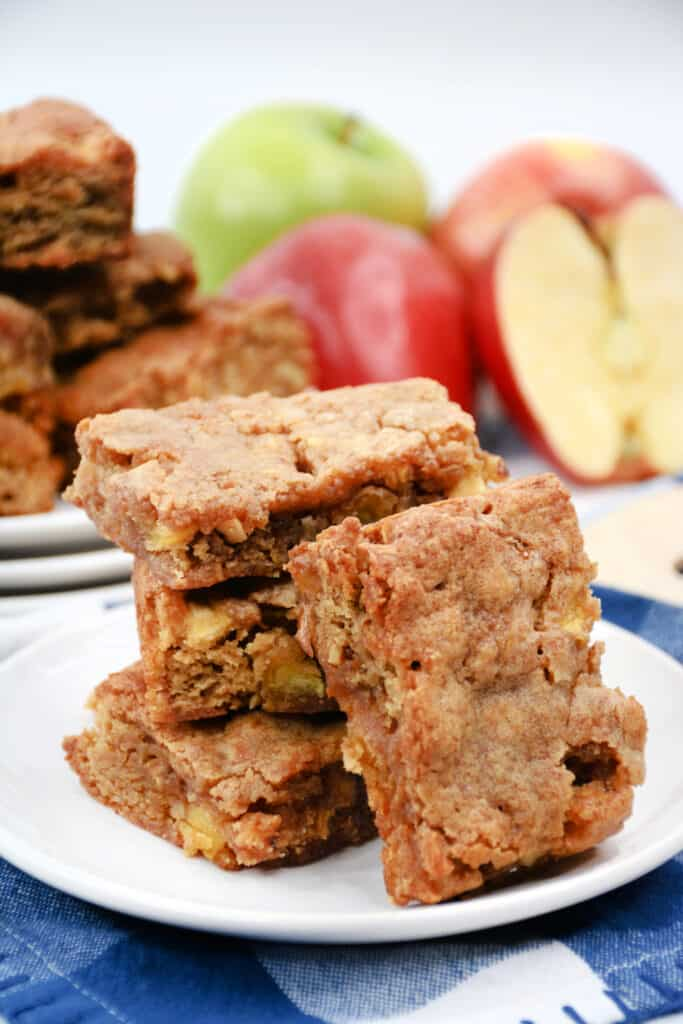 apple blondies stacked on a white plate