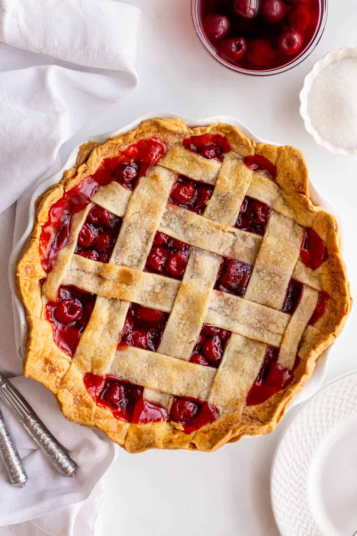 baked easy cherry pie with lattice design in a pie dish
