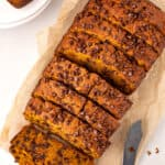 sliced pumpkin chocolate chip bread on parchment paper