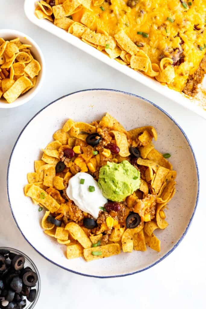 Frito Pie is a classic dish made with ground beef, taco or chili seasonings, cheese, and Fritos that's perfect for a weeknight dinner everyone will love.