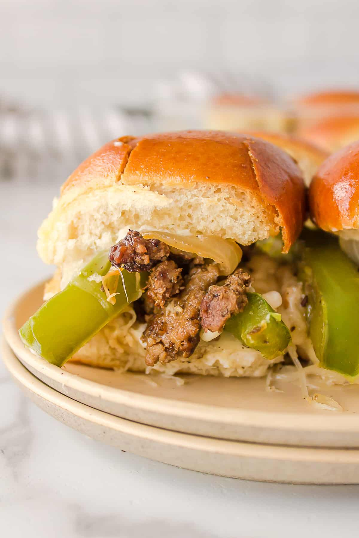 close up image of philly cheesesteak slider
