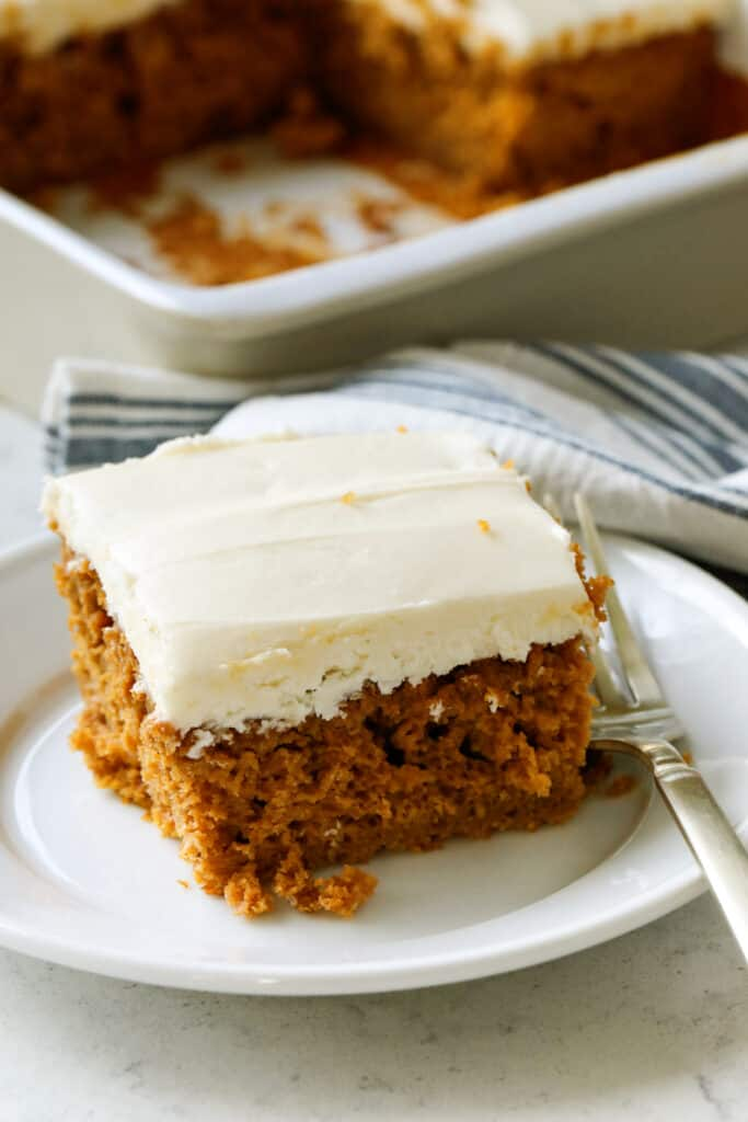 piece of pumpkin cake with a fork on a plate